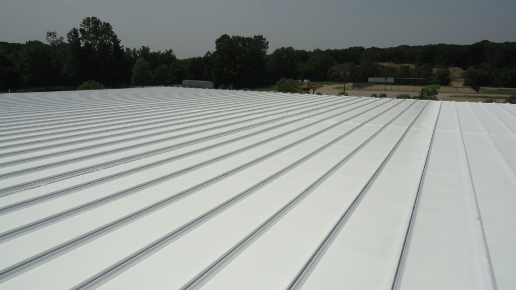 cropped business warehouse metal roof repair Notre Dame IN