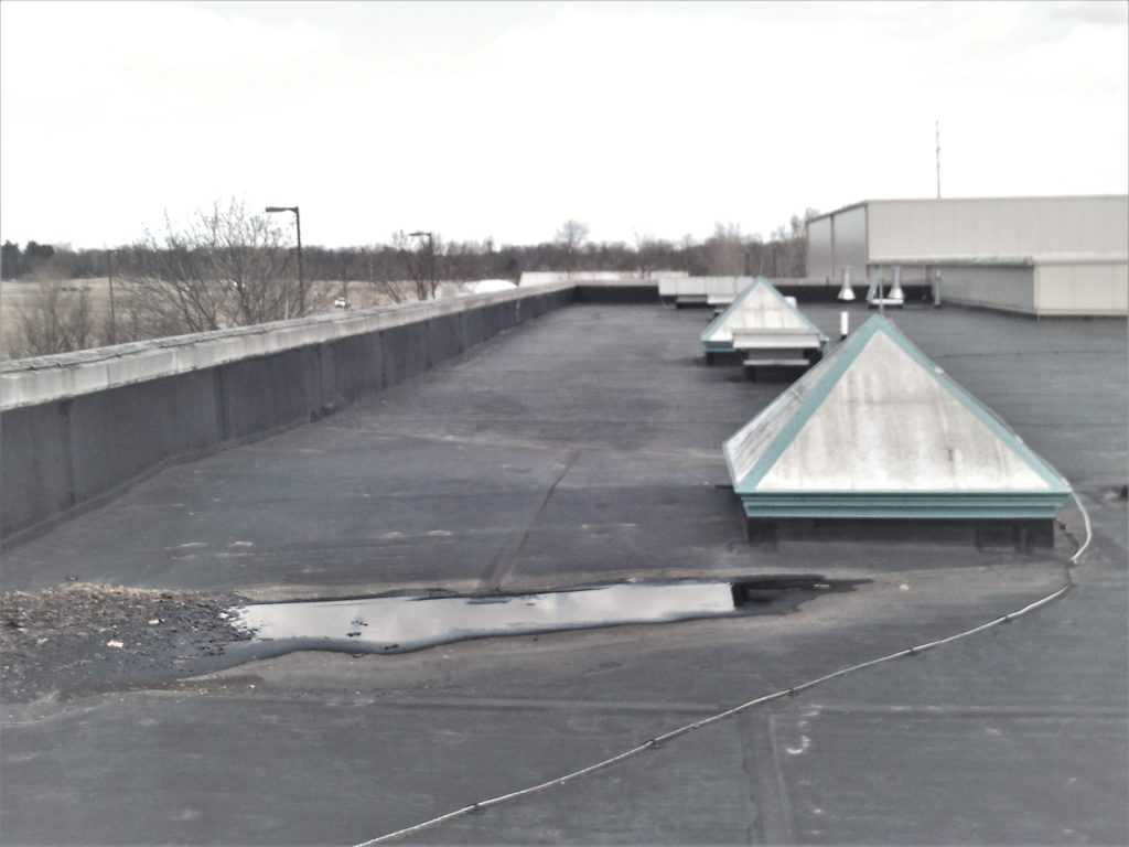 commercial rubber roof repair in notre dame in astec